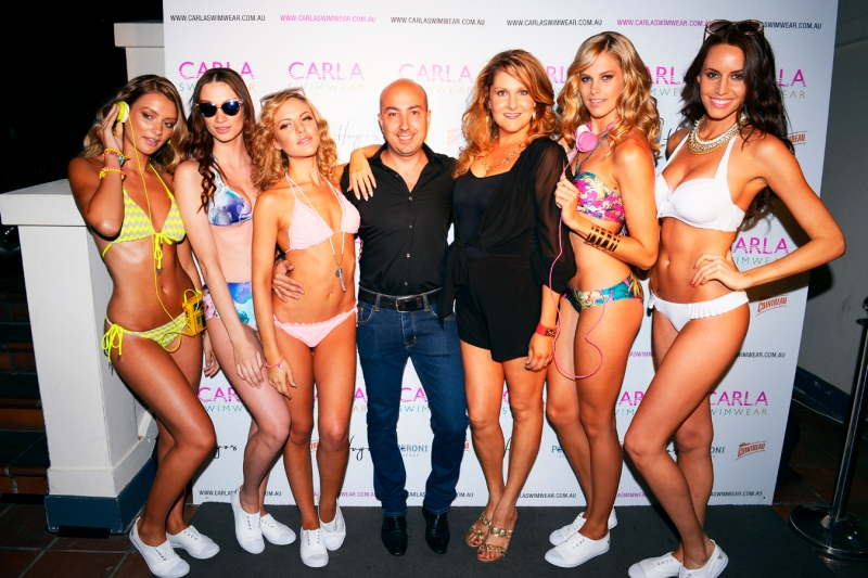 Carla Swimwear owners Leo and Helen Nicola with models